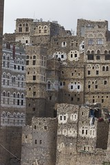 IMG_7905 20-22-41 (mariatarasoff) Tags: yemen sanaa architecture adobe brick ancient old decorative unheritagesite un streets facade mud red white primitive arab arabia arabian countryside landscapes relief brown window arch archway stone traditional sky blue patterns clouds yemeni