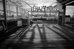 04/52 (2015): Crazy Mouse, Brighton. (Sean Hartwell Photography) Tags: shadow sea blackandwhite holiday monochrome sussex pier seaside brighton empty british decking amusements crazymouse 1122mm canoneosm