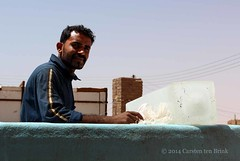 Ice factory stories - portrait with ice (10b travelling) Tags: africa portrait mountain ice sahara river factory northafrica sudan unescoworldheritagesite unesco worldheritagesite nile nubia tombs karima 2013 peopleset napata jebelbarkal carstentenbrink gebelbarkal iptcbasic
