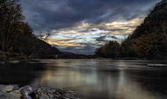Autumn On The Shenandoah River [EXPLORE #1: 5/6/16] (Wilkof Photography) Tags: longexposure autumn trees winter light sunset shadow sky mist mountains reflection tree history nature wet water overgrown fog skyline forest canon river dark lens landscape outside island countryside ruins rocks waterfront sundown cloudy dusk hiking rustic perspective shoreline scenic overcast symmetry foliage explore le westvirginia shore land harpersferry hillside cloudcover potomacriver blueridgemountains shenandoahriver 18mm topography ndfilter virginiusisland neutraldensity 18135mm canont4i wilkofphotography