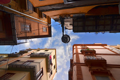 Street lamp (Thomas Roland) Tags: street old city travel houses sky espaa house building lamp valencia up by del lampe spain nikon europa europe crossing cross outdoor himmel tourist trench stadt carrer spanien valncia d7000