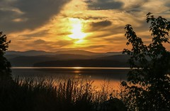 Hello Sun! (SueZinVT) Tags: fog sunrise lakebomoseen silhouettes water lake reflection grasses trees canon70d vermont clouds mountains