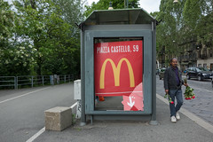 Migrant traffic florist, with smashed McDonald's sign. Torino, May 2013. (joelschalit) Tags: poverty street italy torino italia refugee fastfood mcdonalds turin immigration migrant southasian asylumseeker refugeecrisis
