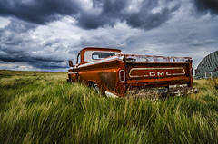 Orange GMC (Stubble Jumper Photography) Tags: orange storm chevrolet abandoned clouds truck rust pickup chevy alberta prairie gmc patina generalmotors