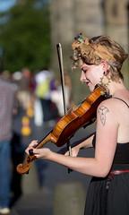 Faith - 5 (Alastair 2008) Tags: fiddle female street entertainer bow piercing strap blacktop