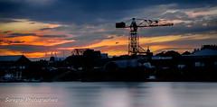 Coucher de soleil estival sur Nantes (Soregral) Tags: btiments longexposure orange sunset ciel eau city grue water couchersoleil sky outdoor nuages ville fil clouds