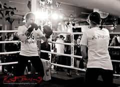 Sparing at the Jaybird launch event. (Kent Johnson) Tags: 1600adjsebwf3785 jaybird fujifilmxpro1 xf35mmf14r boxing sparing womenboxers poweryourpassion sydney streetfashionsydney