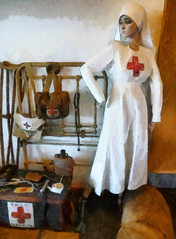 The Nurse (Steve Taylor (Photography)) Tags: city red newzealand christchurch woman brown white art mannequin lady digital bag 3d uniform cross canterbury medical nz trunk southisland nurse cbd crutches waterbottle stethoscope firstaid