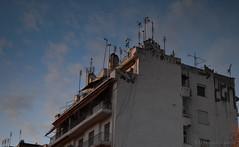 the roof is on fire. ( ) Tags: street blue sky cars church kids night buildings lens photography lights fly kid nikon random obey saints macedonia 55mm thessaloniki late kit edit lightroom kamara 2015 d3200