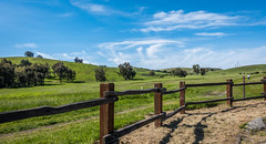 Hiker on the trail - Happy Fence Friday (randyherring) Tags: california park ca blue trees sky plant mountains green grass clouds fence us afternoon unitedstates outdoor hiking sanjose trail hiker santacruzmountains horseriding santateresacountypark santaclaracountyparks