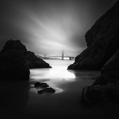Golden Gate Bridge (nlwirth) Tags: sanfrancisco california longexposure sky blackandwhite water monochrome clouds sand rocks goldengatebridge yup nlwirth