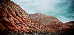 West Canyon Road, Snow Canyon (Arkinien) Tags: blue red sky orange cliff usa white mountain clouds america utah sandstone day desert rocky rockface remote steep sheer snowcanyon mountainscape westcanyonroad