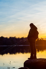 Fisherman at sunset fishing (mikhailanikaev) Tags: fishing lake fisherman sunset rod person river summer casting sport male water action outdoor shore pike twitching one recreation men hobby silhouette leisure activity lure recreational pond active freshwater