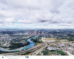 Aerial view on the city of Calgary and the Bow River in Alberta, Canada. (Vincent Demers - vincentphoto.com) Tags: aerialview alberta amriquedunord bowriver calgary canada centreville centrevilledecalgary city cityscape downtown downtowncalgary northamerica photodevoyage photographiedevoyage river rivire rivirebow skyline travel traveldestination travellocation travelphoto travelphotography trip ville voyage vuearienne vuesurlaville