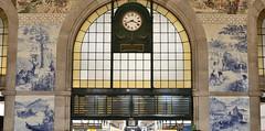 Sao Bento train station, Porto, Portugal (Alona Azaria) Tags: blue clock portugal station train railway arches porto tiles railways azulejos sobento