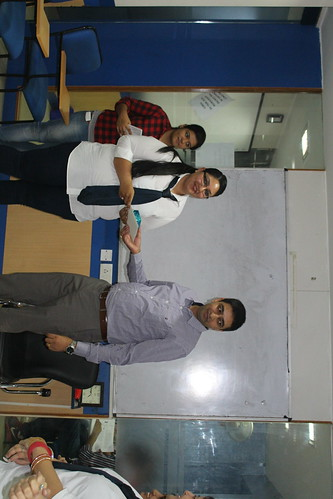 LinguaSoft EduTech's IELTS counselor getting Employ of the month award from CEO Gurvinder Singh Kang