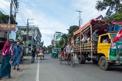 H504_3413 (bandashing) Tags: street trees red england people green yellow truck manchester traffic watch crowd logs sylhet bangladesh carry mentalhealth socialdocumentary aoa airportroad shahjalal bandashing akhtarowaisahmed amborkhana treecuttingfestival lallalshahjalal