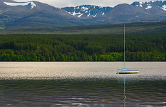 Loch Morlich And The Cairngorm Mountains (williamrandle) Tags: snow mountains beauty reflections landscape scotland boat spring nikon holidays outdoor peaceful serene loch aviemore shimmer lochmorlich sailingboat buoyant cairngormmountains d7100 tamron2470f28vc