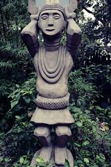 Disneyland Statue (sqrootof5) Tags: statue hongkong nikon nikond7100 sigma1750mm sigmalens tree leaves green grey stone travel disneyland