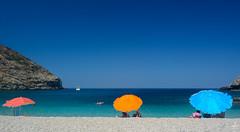 summer colours (Theocharis Kalamaras) Tags: andros aegean bay summer sea sky sun blue beach umbrellas greece aegeansea aegeon hellas  colours zorgos    island greekisland bigblue