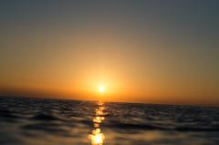 Lonely (KubaFej) Tags: sunrise boat water greek nikon d7000 nikkor 50 14 ai minimalism