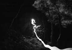 Arch Nemesis (Ben Lockett) Tags: mysterious glow cave dramatic mystery rocks scrambling climbing lines self woods stacked 1740l 5d canon noise mono white black forest dark flare silhouette person nemesis arch led torch lighttrail light nightphotography night