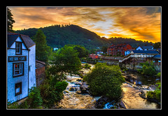 Sunset over Llangollen (Kevin, (Away 21 Oct / 9 Nov) Traveling) Tags: llangollen wales riverdee river hdr sunset canon1855mm architecture sky colourful kevinwalker britain trees station trains railwaystation
