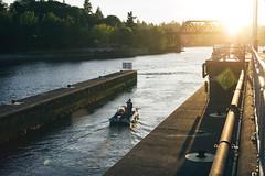 zones (mental_digestion) Tags: seattle leica bridge sunset sun water docks boats 50mm boat waves lensflare boating watersports cinematic tides sunflare ballardlocks leicam