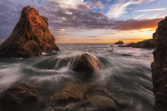 Red Rocks at Corona Del Mar (Michael Bandy) Tags: ocean orange seascape beach water clouds landscape rocks orangecounty oc coronadelmar cdm
