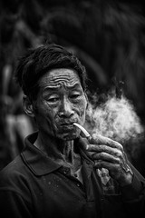 Yunnan's smoke culture-3~ (~mimo~) Tags: china portrait people blackandwhite man smoke pipe culture tradition yunnan nicotine honghe