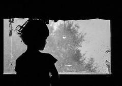 inside looking out at the rain (Explored) (krøllx) Tags: spain lliurona people bw monochrome 1411290125 simple explore child rain weather children silhouette shadow nikc window innside light