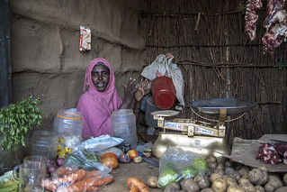 A Somali woman runs a small grocery shop in Kakuma Refugee Camp, northern Kenya.