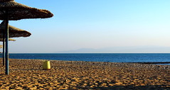 The Beach (Khaled M. K. HEGAZY) Tags: blue red sea sky brown white black beach nature water yellow closeup seaside nikon outdoor egypt parasol coolpix p520 rassedr
