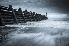 Walton Defences (scott.hammond34) Tags: uk england sky seascape storm beach clouds grey mono coast blackwhite waves outdoor shore groyne essex seadefences waltononthenaze