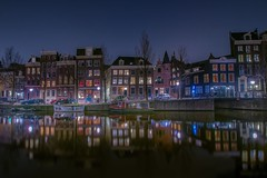 enjoying the place (karinavera) Tags: street city longexposure travel urban holland color netherlands colors amsterdam architecture night buildings boat canal cityscape view canals nikond5300