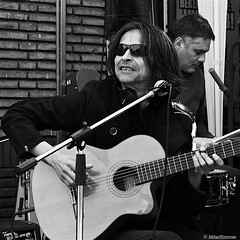 The Musician (Akbar Simonse) Tags: street people bw musician holland blancoynegro netherlands monochrome sunglasses square zwartwit guitar nederland streetphotography denhaag shades bn haag thehague zonnebril vierkant lahaye sgravenhage agga straatfotografie dscn1842 akbarsimonse prijspaleis terletstraat