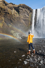Skogafoss (Claire Willans) Tags: portrait people cliff nature water river waterfall iceland rainbow power lone awe skogafoss inawe