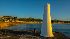 Cullen Light House In Golden Light (williamrandle) Tags: sea lighthouse seascape monument water stone nikon village harbour outdoor bluesky viaduct northsea moray goldenhour cullen goldenlight banffshire northeastscotland d7100 sigma816mmf456dc