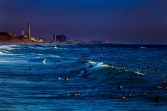 surfing in Tel-Aviv beach (Lior. L) Tags: city sunset sea sky beach skyline israel telaviv colorful waves action surfing surfers mediterraneansea actionphotography surfingintelavivbeach