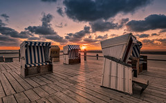 Beach Chairs (Stefan Sellmer) Tags: light sunset sky color beach water clouds germany de deutschland sand colorful flickr outdoor northsea sunbeams beachchairs schleswigholstein stpeterording sanktpeterording