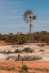 Outback Windmill (robertdownie) Tags: blue trees sky sun water windmill dam salt dry australia outback bore simplex