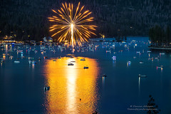 Sunburst (Darvin Atkeson) Tags: california light lake snow mountains reflection water rain forest day glow fireworks bass nevada 4th july sierra pines shore independence 4thofjuly basslake oakhurst elnino 2016 darvin atkeson darv lynneal yosemitelandscapescom