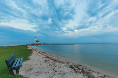 The lighthouse of Marken, The Netherlands (sandergroffen) Tags: vuurtoren lighthouse marken coast ijsselmeer holland clouds cloudy blue hour landscape photography beach bench markermeer trouwenzoalsjulliewillen wedding location