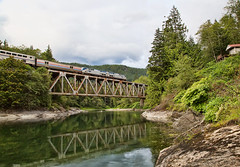 Amtrak Empire Builder Over Skykomish River (cheryl strahl) Tags: amtrak empirebuilder train eastbound cascademountains skykomishriver washington unitedstates trestle river reflection clouds engine bridge ngc