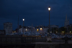 La Rochelle (blue hour) (Michel Couprie) Tags: france charente larochelle harbor port bluehour sea streetlamp night dark dawn morning light composition water boats tower architecture canon eos ef10028lmacro couprie