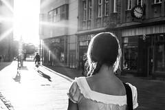 Abendsonne (Rias-Roc) Tags: light woman sun white black ex girl monochrome female contrast canon lens eos back sigma tor kontrast schwarz rostock ktv flares gegenlicht 30mm weis hsm 550d kröpeliner blendenstern