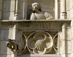 "A woman and a monkey peer from a ""window"" in the 15th C. facade of the palace of Jacques Coeur, Bourges, France (Hunky Punk) Tags: houses sea woman france west window stone architecture buildings monkey bourges berry faades stonework shell carving cher figure renaissance palaces false centrevaldeloire jacquescoeur hunkypunk spencermeans"