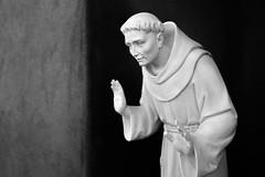 Saint Francis (turndeaux) Tags: blackandwhite bw newmexico santafe monochrome saint statue catholic fuji christian adobe saintfrancis x100t