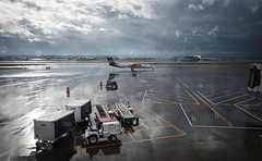 magical break in the rain (angeloangelo) Tags: light storm reflection glass lines rain tarmac clouds contrast portland airplane airport amazing break wide dramatic wideangle clear pdx drama magical runway prop turboprop alaskaairlines bombardier uaa q400 horizonair dhc8402 n443qx