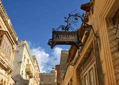 atrium wine bar (mcfcrandall) Tags: street urban sign bar buildings restaurant malta balconies ornate atrium gozo